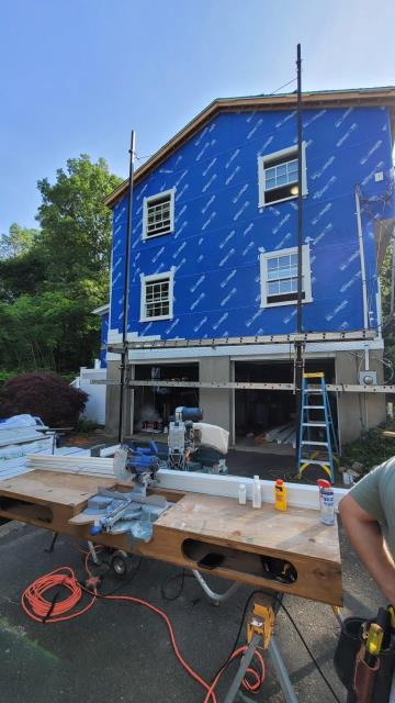 New Canaan, CT - Beautiful blue wall of Henry Company Blue Skin VP100.