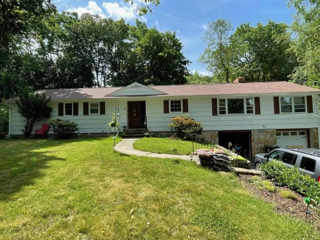 Trumbull, CT - This homeowner is interested in new Marvin windows, James Hardie siding, and a deck with a patio slider!