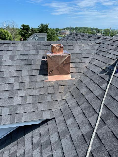 Fairfield, CT - This roof is getting an updated chimney, complete with 16oz copper chimney flashings and roof to sidewall flashings. These flashings ensure that the connection between the chimney and roof is watertight.
