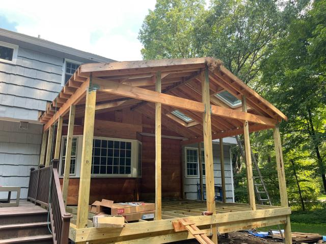 Weston, CT - In-progress shot of a screen porch in Weston. The four VSS S06 solar venting skylights have been installed in the roof providing the porch with tons of natural light.