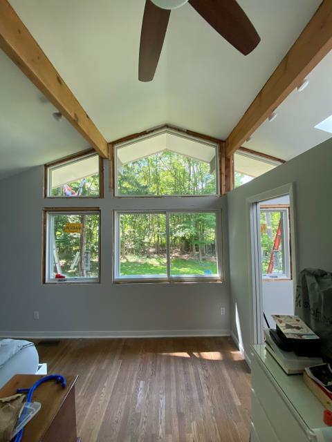 Wilton, CT - We've installed Marvin Elevate Direct Glaze Polygon windows and Glider windows to increase the amount of natural light that enters this master bedroom.