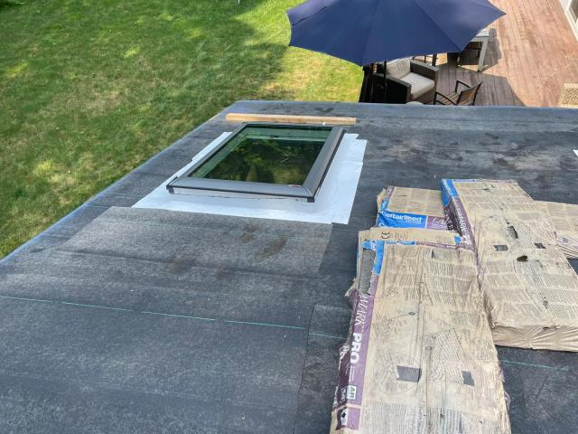 Weston, CT - Bird's eye view of this screen porch. We've installed four of these Velux VSS M06 Solar Venting Skylights and are matching the main home's current roof with Certainteed Landmark Pro shingles.