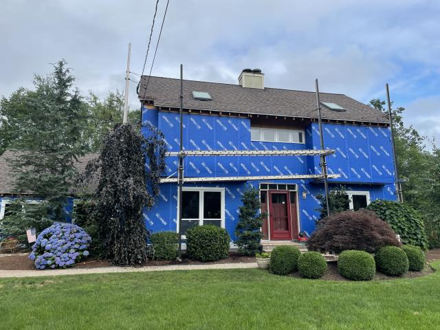 Shelton, CT - This house is now fully wrapped with Henry Blueskin VP100 house wrap and prepped for James Hardie fiber cement siding.