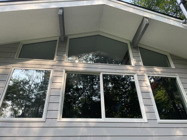 Wilton, CT - This Wilton home has transformed with new Marvin Elevate windows and James Hardie fiber cement siding in Pearl Grey. These windows bring so much natural light and character into this home, while the fiber cement siding will protect the home for years to come.