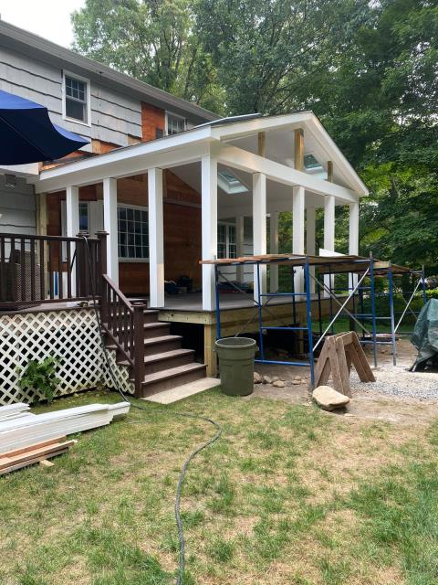 Weston, CT - This custom screen porch is well underway here in Wilton. The addition includes four Velux skylights and TimberTech AZEK decking in Dark Hickory.