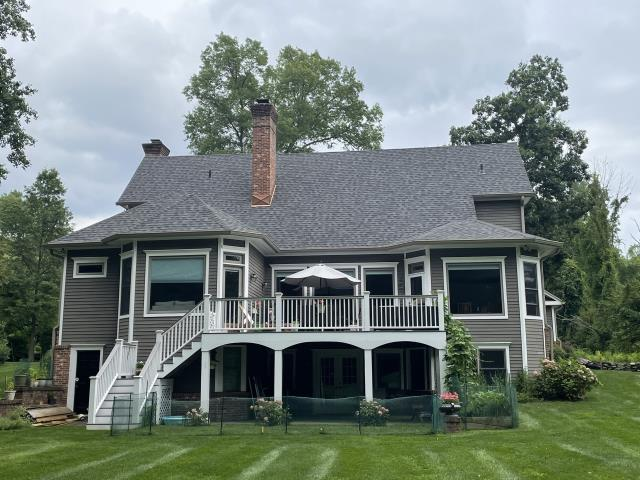 Stamford, CT - Final results of a new Certainteed LandmarkPro Asphalt roof! We tore off the old shingles, and installed the new singles in beautiful Pewterwood. We also added new 16oz copper chimney flashing to ensure that the connection between the chimney and roof is watertight.