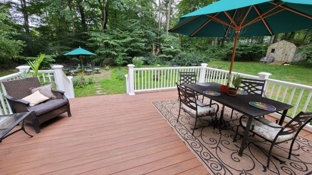 Trumbull, CT - Check out this completed AZEK Vintage decking with premier railings in Trumbull! This deck size is perfect for this family and the entertaining they wish to do at their home. AZEK decking comes wit a 50-year fade and stain warranty and a limited lifetime warranty for added piece of mind!
