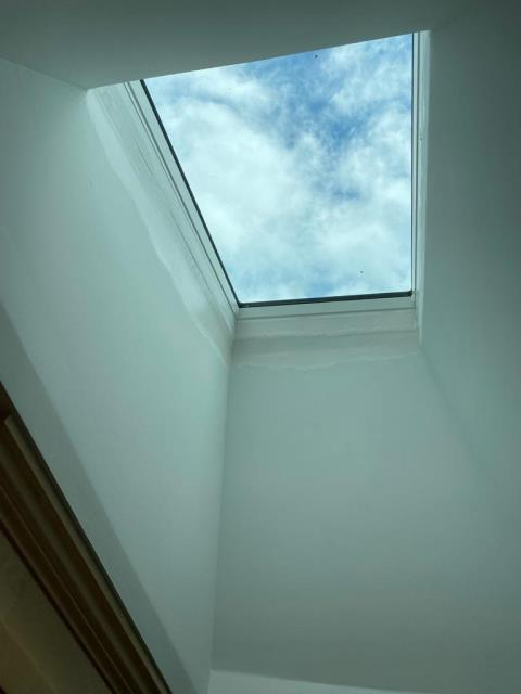 Stratford, CT - We installed this new Velux fixed skylight in this Stratford home. What you can't see is the CertainTeed winter ice and water shield on the roof around the skylight base to make everything weather tight. The installation was complete with some new asphalt shingles to match the existing roof.