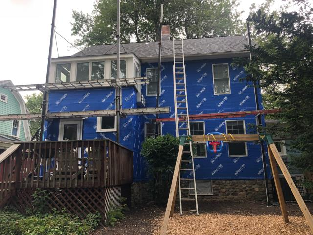 Fairfield, CT - In-progress shot here in Fairfield. We have torn away the old siding and have added Henry BlueSkin VP100 house wrap that is self-adhesive and the best defense against the damaging effects of water and moisture intrusion.
