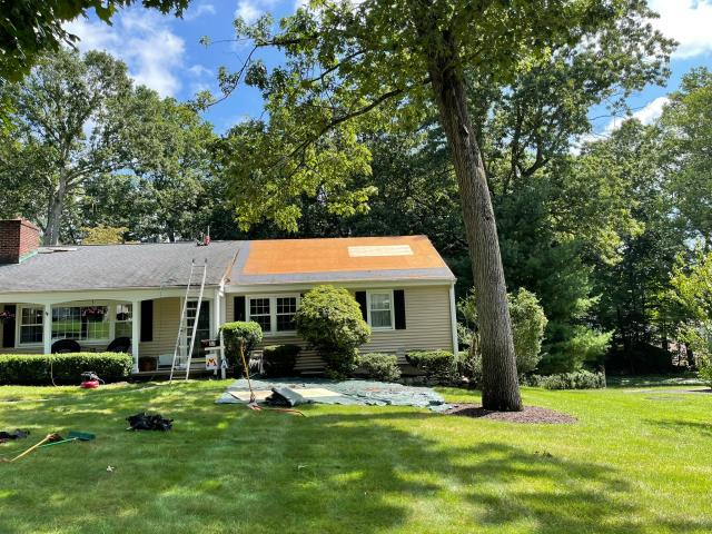 Stamford, CT - Roof repair is underway at this home in Stamford. We are installing new CertainTeed Landmark Pro singles to the right side of the house to fix the damage that has ensued from a recent storm.