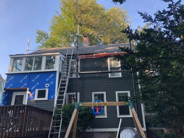 Fairfield, CT - Moving right along here in Fairfield on this James Hardie siding project. These homeowners are so excited to see the progress and how nice the Iron Gray color looks on their home!
