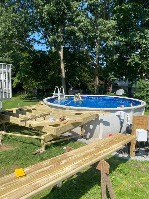 New Canaan, CT - This backyard is getting an upgrade with a new deck to access their above-ground pool! Currently in progress, we have set the foundation and will install AZEK vintage collection decking in Coastline.