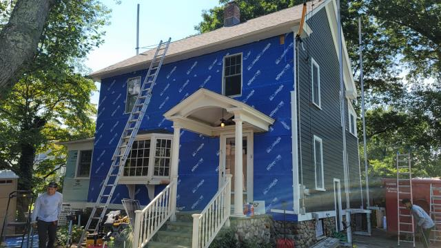 Fairfield, CT - Great progress in Fairfield installing James Hardie fiber cement siding. As a layer of protection, we apply BlueSkin VP100 house wrap to provide a weather tight barrier between the home and the elements.