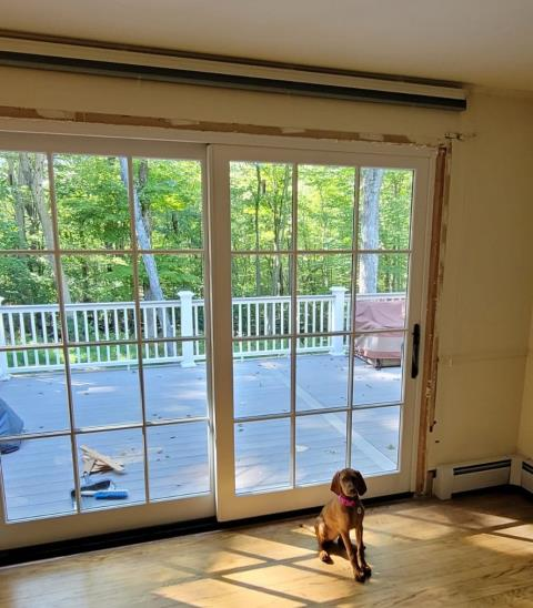 Trumbull, CT - This proud family puppy is happy to have a new Marvin Elevate slider door for easy access to the deck and outdoors. Her family just expanded their living space with a new AZEK deck, and she can't wait for her new backyard to be complete.