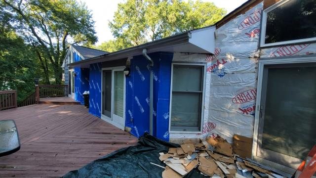 Stamford, CT - Work has begun at this home in Stamford, removing the old siding and house wrap and replacing it with new Henry Blueskin VP100 house wrap and James Hardie fiber cement siding. The homeowners are excited to see their home's exterior transform into something new and beautiful with durability for peace of mind.