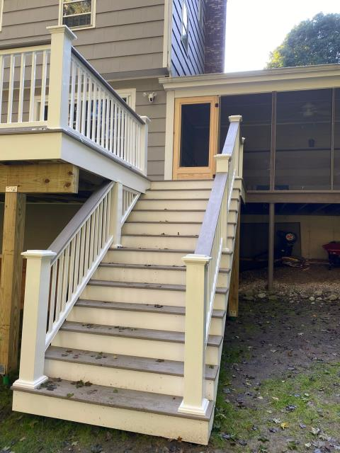 Trumbull, CT - This deck includes stairs on the side for access to the yard from the deck and the home. It features Coastline deck boards from AZEK's vintage collection and drink rails that match the deck boards. This deck will provide added space for the family to entertain and enjoy.