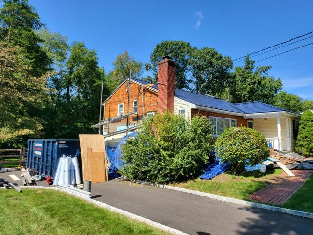 Stamford, CT - Here in Stamford, we've removed all of the old siding and are preparing the home for Henry BlueSkin VP100 house wrap. This house wrap is weather resistant and can be exposed to the elements without siding for up to 180 days!