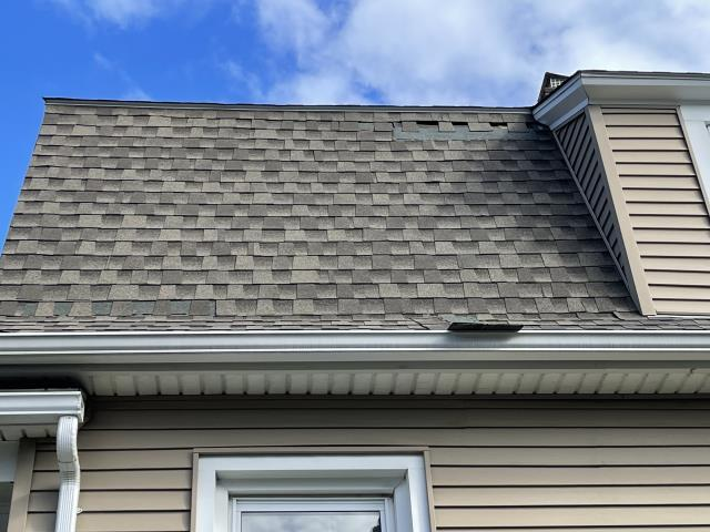 Stratford, CT - This Stratford home requires some TLC after a recent storm destroyed part of their roof and siding. Burr answered the call, and we will be repairing the damage from the strong winds that affected their siding and roof.