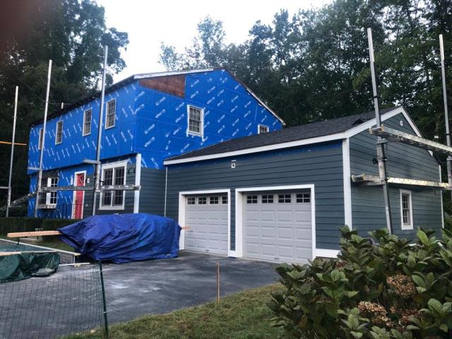 Easton, CT - Amazing progress here in Easton on this lovely home. As you can see we are just about done with the garage portion of the home and making our way to the main house. We are installing James Hardie fiber cement siding in Deep Ocean with PVC white corner boards.