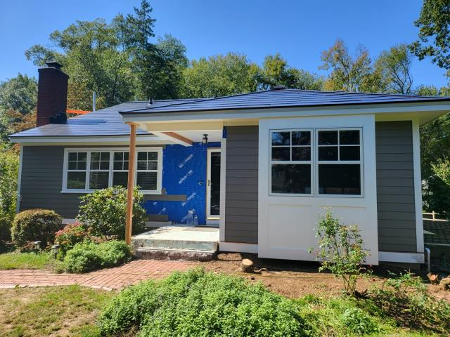Stamford, CT - Here in Stamford, we are installing James Hardie fiber cement siding in Aged Pewter. This renovation also features Marvin windows that were installed before beginning the siding work.