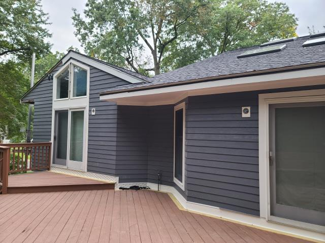 """Stamford, CT - Making great progress here in Stamford installing James Hardie fiber cement siding in Night Gray at a 5"""" exposure. This homeowner is so excited to see his home change before his very eyes and can't wait for the final transformation."""