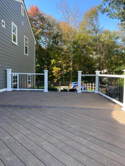Stamford, CT - This AZEK deck is just about complete as part of this full exterior renovation to this Stamford home. This makeover also features James Hardie siding and Marvin Elevate windows.