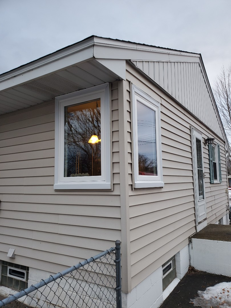 Minneapolis, MN - Replaced two corner kitchen windows that  wasn't correctly flashed. We replaced them with energy efficient Soft-lite vinyl casement windows.  One of the most energy efficient crank out windows available!