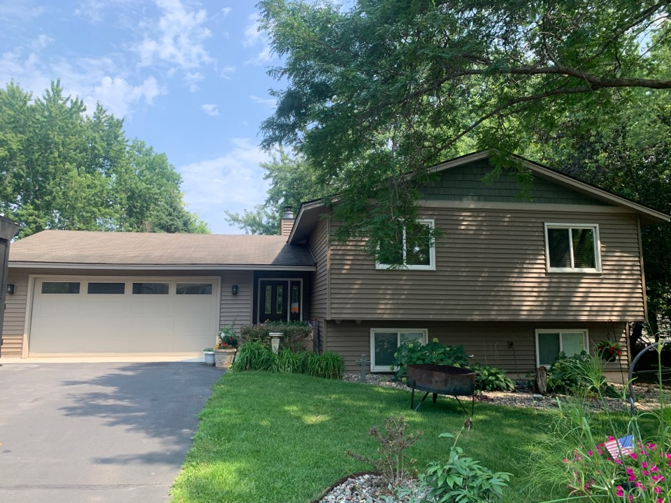 Chaska, MN - Here TJ Exteriors installed new Alside Charter Oak vinyl siding with aluminum cladded windows and CertainTeed Shakes in the gable. We also replaced the old soffit and facia with new Edco aluminum soffit and facia in Sandtone.