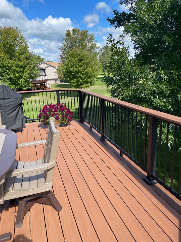 """Belle Plaine, MN - New Azek Timber Tech decking with drink rail and 7 1/4"""" boarder replacing aged wooden deck. Aluminum powder coated Ultralox railings."""