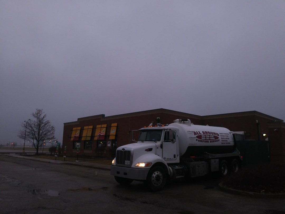 Peru, IL - Pump and clean outside grease trap
