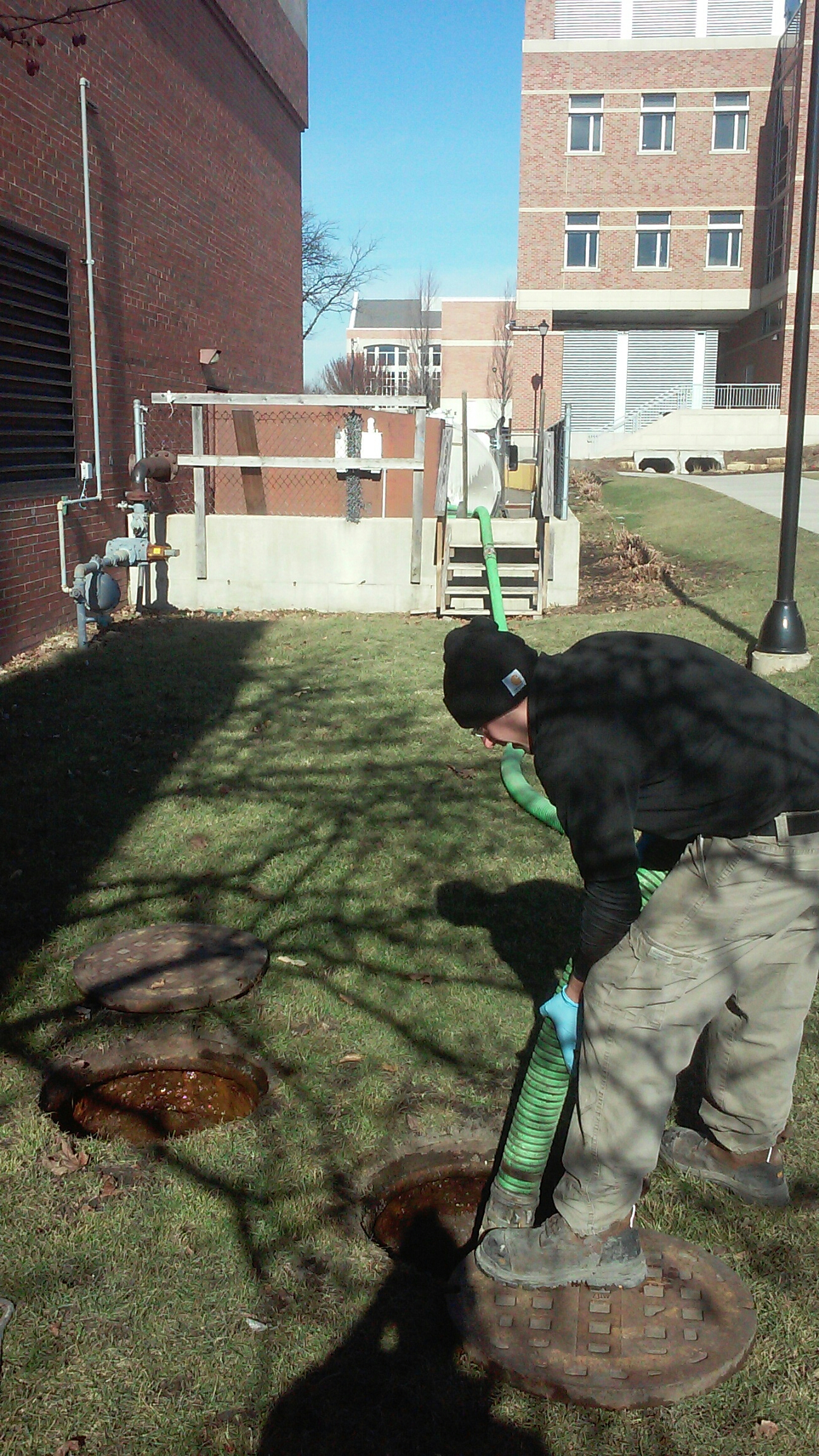 Wheaton, IL - Pumping and cleaning a grease trap for a major college.
