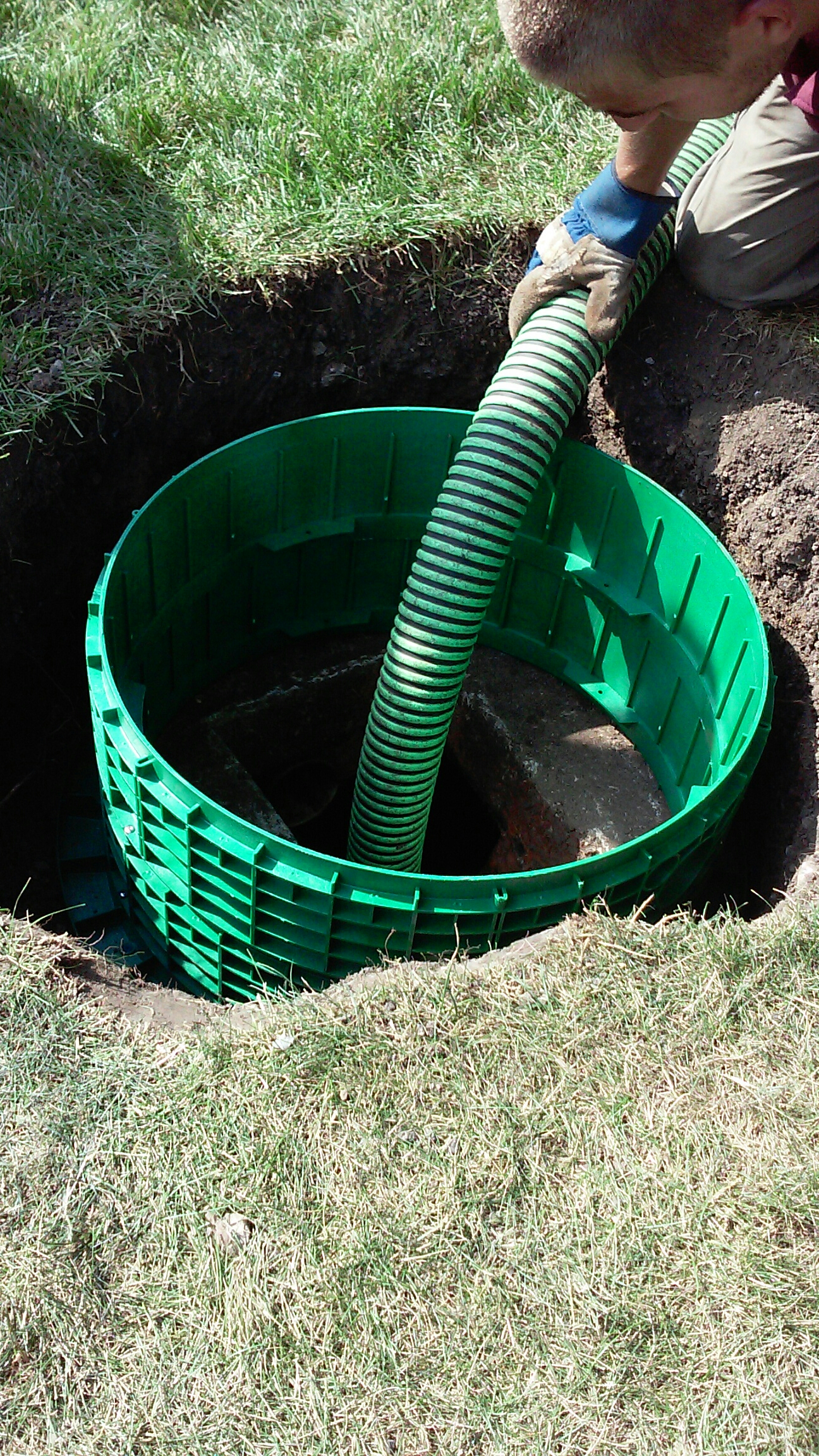 Maple Park, IL - Pumping septic tank and installing a riser system.