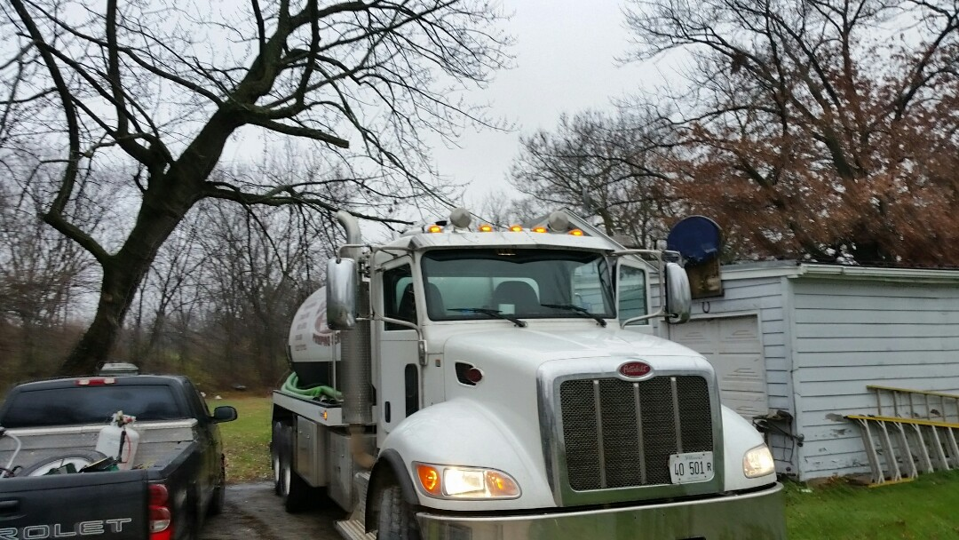 Aurora, IL - Pump and clean septic tank