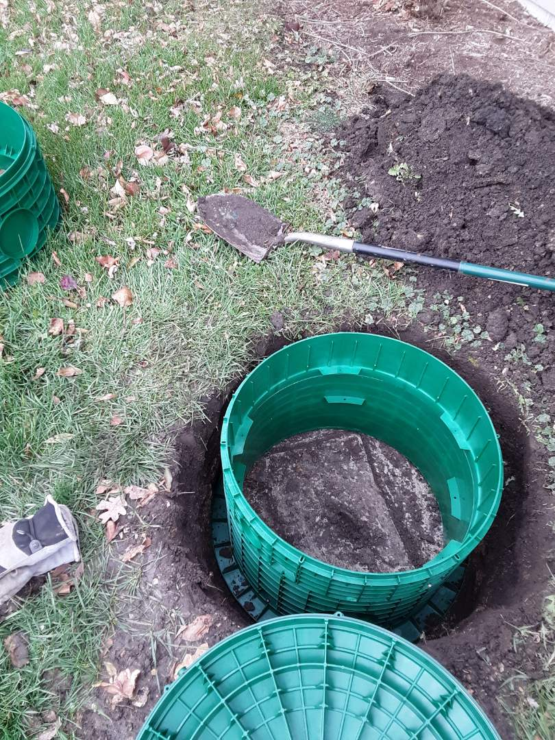 Kingston, IL - Installing riser systems on septic tank