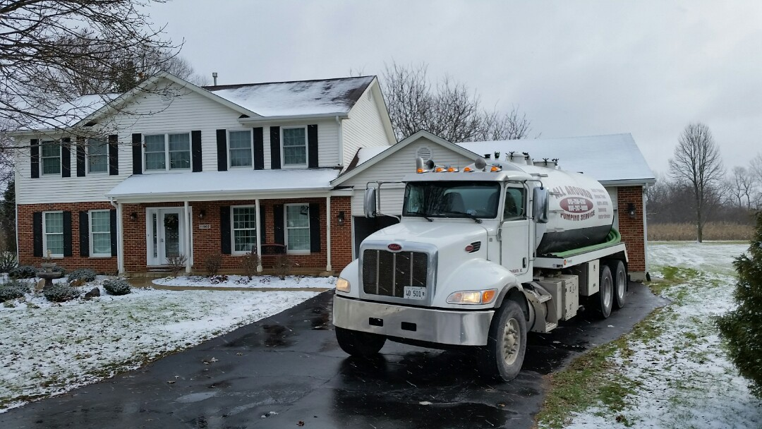 Huntley, IL - Pump and clean septic tank