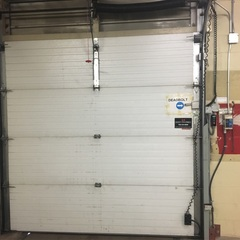 Service Call: Commercial Overhead Door  Issue: The operator has stopped working and the door is stuck closed. Work Completed: The technician realigned the photo eyes and reattached the track that was loosen when the door was hit. The technician lubricated all moving components on the door and tested multiple time to ensure safe and proper operation.