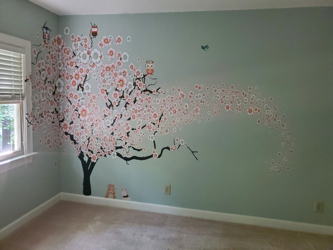 Raleigh, NC - Working on a clients nursery with this wall mural.  With owls, foxes and bears looking over their little one, im sure they will sleep through the night under the cherry tree.  These kids murals are fun.
