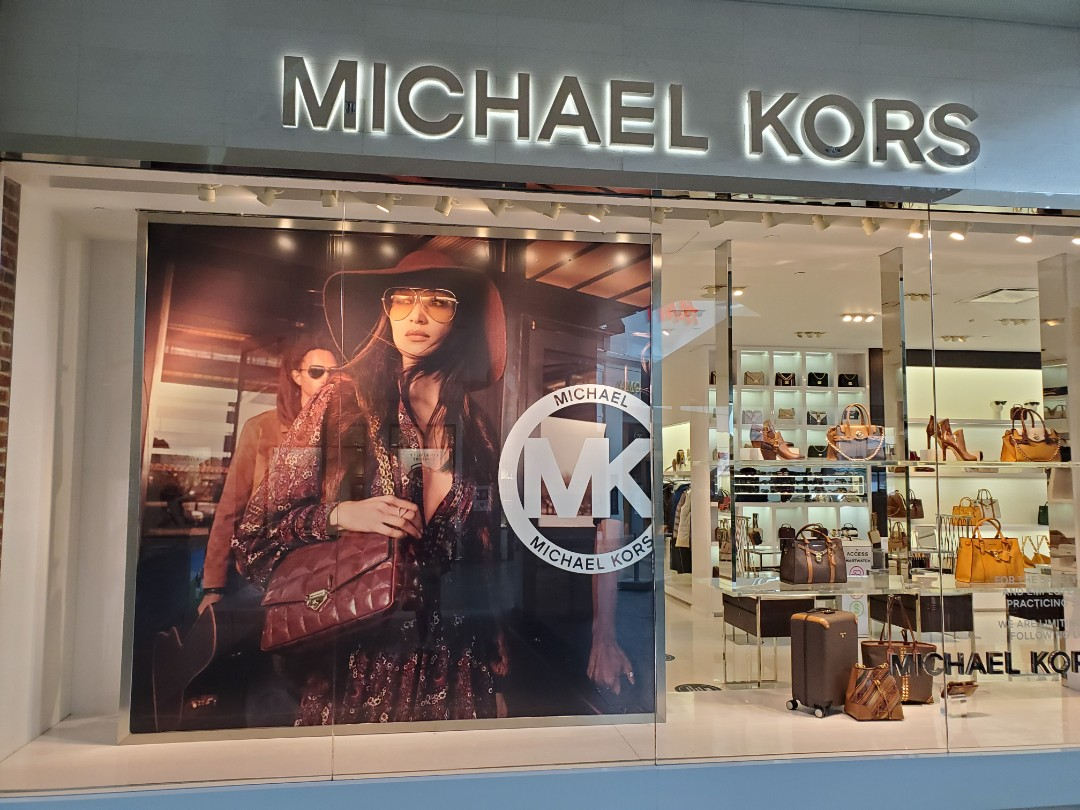 Helping America's retail stay in business check out these Michael Kors wall mural at their store it Raleigh North Carolina