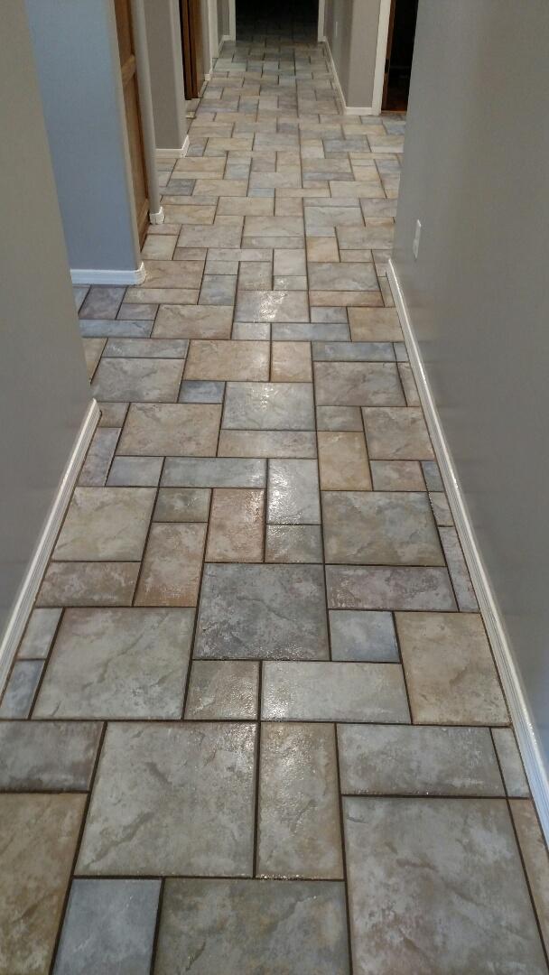 Gilbert, AZ - Cleaned carpet, an area rug, and tile & grout for a new PANDA family in Gilbert, AZ 85298.