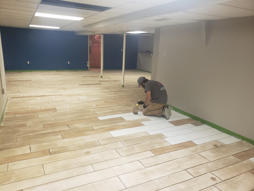 Eaton, OH - Epoxy basement flooring.  Waterproof rustic concrete wood