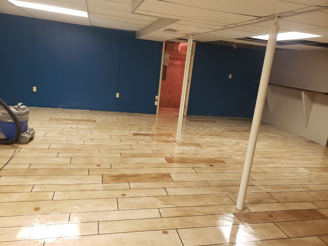 Eaton, OH - Epoxy basement flooring waterproof rustic concrete wood finish