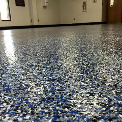 Troy, OH - Epoxy Flake flooring is a strong industrial coating designed to be an alternative to Terrazzo. This is perfect for epoxied garage floor, patios, pool deck renovations, and much more. Contact us today for fast and friendly service!