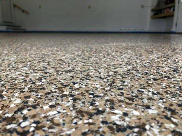 Middletown, OH - With our concrete coatings epoxy flake flooring, your garage will be the center of attention that people what to gather around! Using any of our custom blends will give you infinite possibilities of color combinations !! Check them out today!