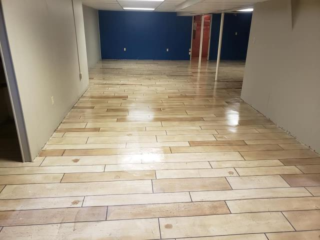 Bellefontaine, OH - By remodeling your basement floor, you can create an area that will be THE space that everyone wants to hangout at!