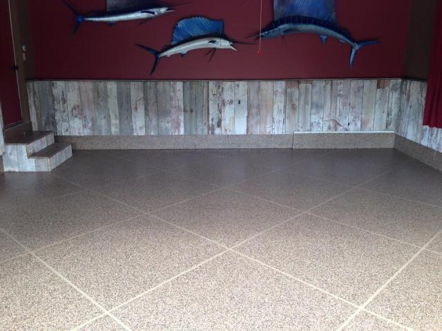 Marysville, OH -  Epoxy flooring is the way to go when planning on remodeling any concrete in or outside your home! With easy maintenance, custom flooring, unique designs, and easy to clean; this floor is perfect for any family with kids and/or pets!