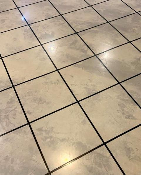 Marysville, OH - This Venetian Tile concrete floor is unbelievable! I just love the real tile look! So smooth and polished! Without a doubt better than a concrete floor! Looking at this makes me feel ready to be productive for my day! I highly suggest giving American Dynamic Coatings a try!
