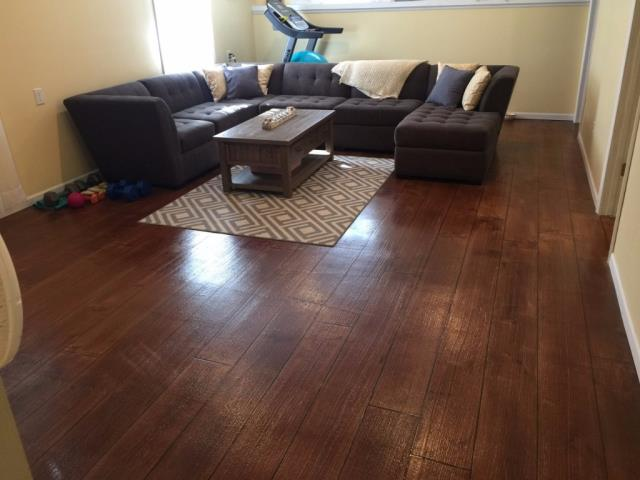 Dayton, OH - Stunning wood planks! This decorative concrete coating could not have turned out better! The wood-like epoxy coating makes the entire room more relaxing! And I know that neither pets nor foot traffic is going to take the shine away! American Dynamic Coatings does high-quality work!