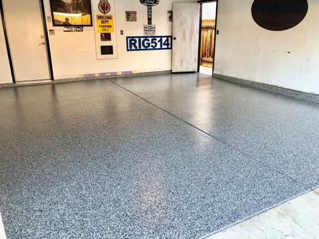 Bellefontaine, OH - Perfect garage floor. American Dynamic Coatings goes in and gets the job done! No hassle, well-mannered service, very enjoyable to do business with. Their work is spotless, the quality is great. I really like the floor they did in this garage. It feels great to walk on and pleasing to look at!
