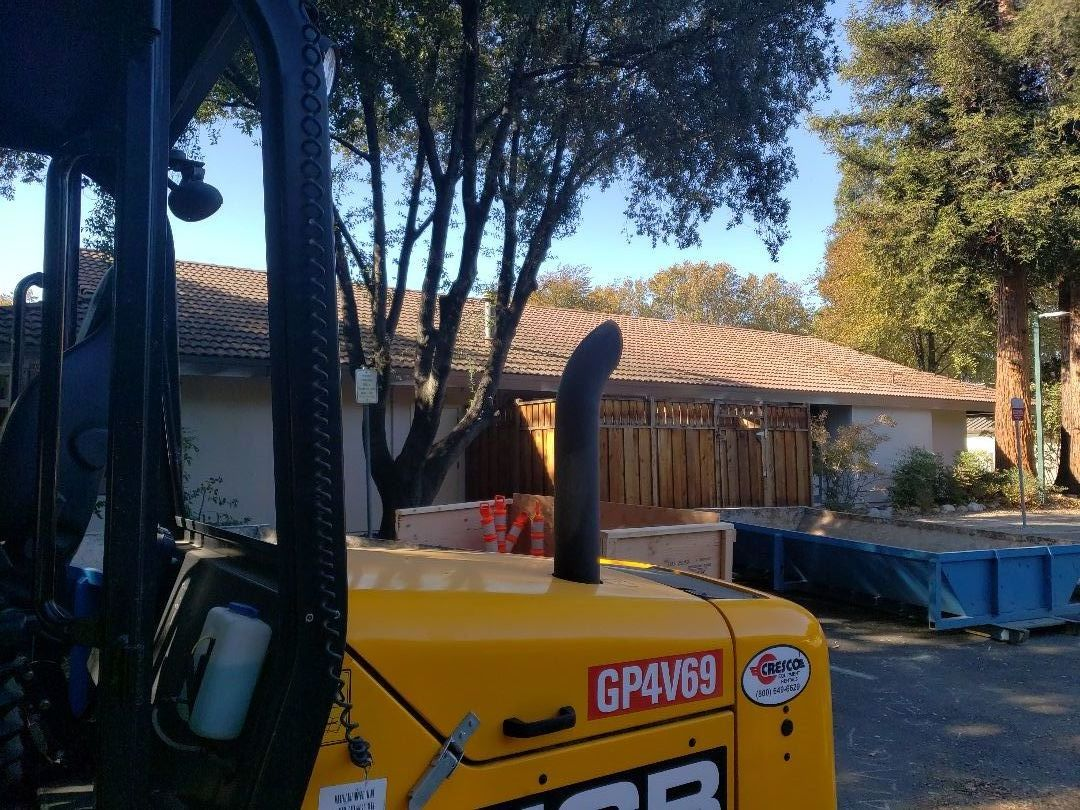 Walnut Creek, CA - Removing roof tiles and replacing with metal.