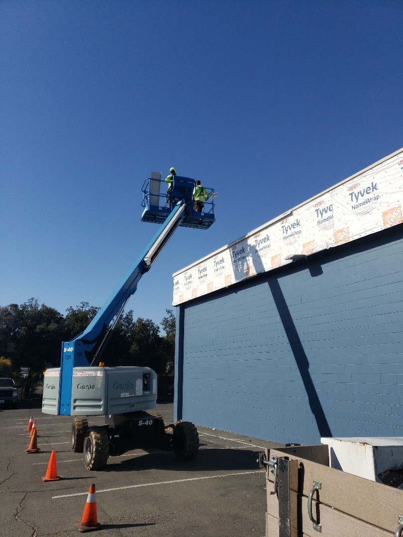 Walnut Creek, CA - Lawrence Way. Installing Sikalastic silicon roof on the flat roof and installing recycled metal siding on the exterior.